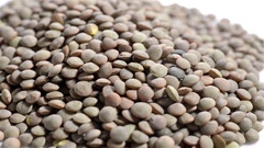 Close up top view of lentils in foreground rotating Stock Footage