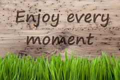Bright Wooden Background, Gras, Quote Enjoy Every Moment Stock Photos