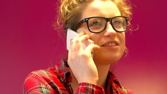 Pretty girl in red, checked shirt receives good news, steadycam shot Stock Footage