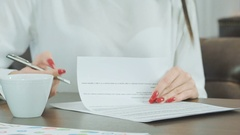 Woman hand with red nails signing formal papers Stock Footage