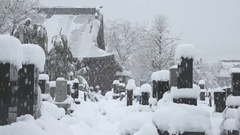 Heavy Snow Blankets Cemetery During Major Winter Storm Stock Footage