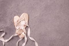 Ballet pointe shoes on pink background Stock Photos