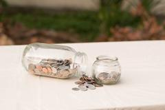 Money in a jars Stock Photos