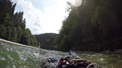 FPV: Unrecognizable man swimming and descending down the river with the flow Stock Footage