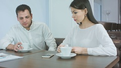 Sick businessman sneezing while worried female partner checking his head Stock Footage
