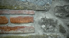 Mix of Bricks and Stones Wall Background - 29,97FPS NTSC Stock Footage