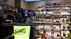 Pan shot of people ordering foods at Tim Hortons restaurant Stock Footage