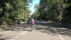 CLOSE UP: New Yorkers involved in sport activities in Central park on sunny day Stock Footage
