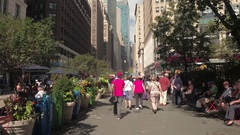 FPV, HYPERLAPSE: Walking along crowded Broadway st in New York on busy sunny day Arkistovideo