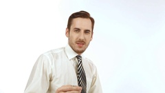 Young businessman throws up a coin Stock Footage