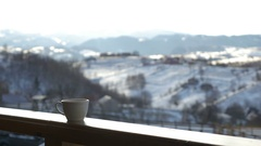 Cup of hot coffee on wooden railing Stock Footage