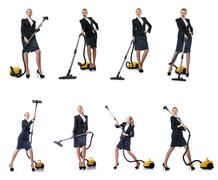 Businesswoman cleaning with vacuum cleaner on white Stock Photos