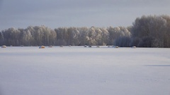 Panoramic UHD video of Altay region country fields with haystacks under sno.. Stock Footage