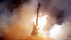 Electric guitar set on fite. Burning in slow motion. Stock Footage