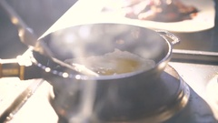 Man overturning omlet in frying pan in 4K Stock Footage