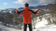 Man enjoying a wonderful sunny day in winter season at the top of the mountai Stock Footage