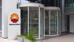 Street signage board with PetroChina logo. Modern office building. Editorial 4K Stock Footage