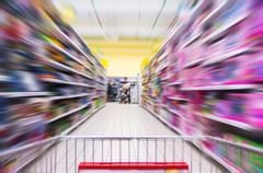 Shopping Cart View on a Supermarket Aisle and Shelves - Image Has Shallow Depth Stock Photos