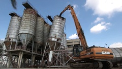 Dismantling old silo tanks with bulldozer Stock Footage