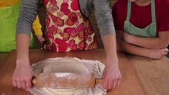 Three kids kneading dough for pizza Stock Footage