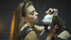 A girl and her pet a cute piggy Stock Footage