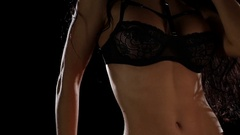 Busty girl in bikini posing for the camera. Close up Stock Footage