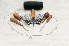 Leather craft tools on a leather background. Craftsman work desk Stock Photos