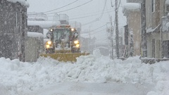 Snowplow Clears Huge Amount Of Snow From Road During Blizzard Stock Footage