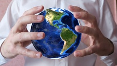 Man Holding Globe In Hands 4 Stock Footage