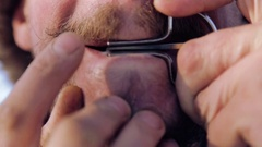 Portrait of a man playing a harp. Face closeup with a musician Jew's Harp. Stock Footage