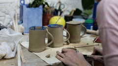 Ceramics. Making the cover for the cup in the ceramic workshop Stock Footage