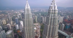 High Aerial Shot With Camera Tilt of Kuala Lumpur Office Skyscrapers Stock Footage