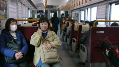 Commuters Tourists People Traveling On Train In Hiroshima Japan Asia Stock Footage