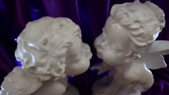 Statues of two kissing angels. wedding decoration Stock Footage