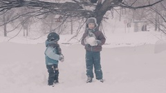 A children playing in the park in the snow. Portraits of two boys. Stock Footage