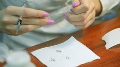 Girl decorates nail rhinestones. Nail design with rhinestones closeup. Jobs Stock Footage