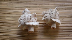 Hand Carved Wooden Heads of Balinese Theater Puppets. Taman Nusa Cultural Par Stock Footage