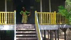 Woman Demonstrates Balinese Native Dance on Porch of Traditional House Stock Footage
