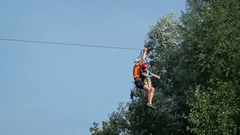 Father and Son Riding a Zipline at an Adventure Park. FullHD footage Stock Footage