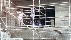 Construction Workers Taking a Break on a High Scaffold at their Work Site Stock Footage