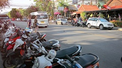 Tourists Carefully Cross the Beach Road in Ao Nang Stock Footage