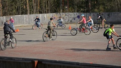 Local Children Riding Bicycles at a Rural Park in Polyarnie Zori Stock Footage