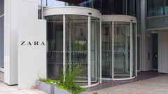 Street signage board with Zara logo. Modern office building. Editorial 4K 3D Stock Footage