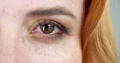 Extreme close-up of a brown eye of a woman with a foxy hair Stock Footage