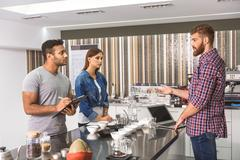 Working atmosphere in coffee room Stock Photos