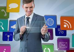 Businessman using interface screen against social icon set Stock Photos