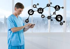 Doctor using mobile phone with application icon Stock Photos