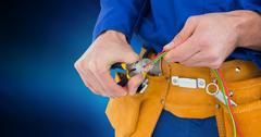 Mid section of handyman using pliers Stock Photos
