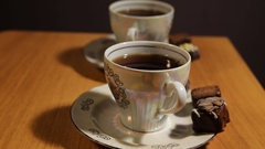 Tea set on the table with chocolate candy Stock Footage