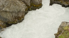 Wide high angle crane shot of river rapids flowing between rocks / Iceland Stock Footage